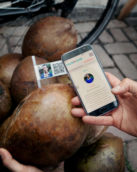 By scanning the QR code on the coconuts, consumers can see where the coconuts came from and what was paid to the farmers.